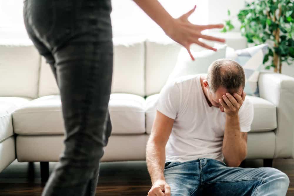woman beating his husband