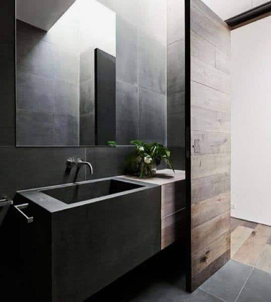 Stone And Wood Make A Dark Masculine Interior: Top 60 Best Black Bathroom Ideas