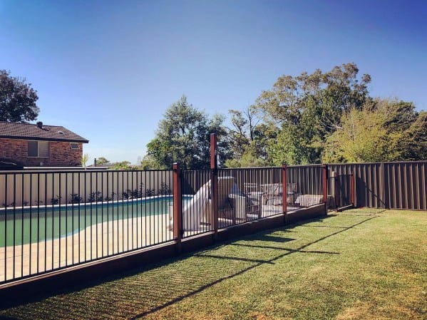 Wood And Vertical Bars Metal Home Pool Fence Ideas
