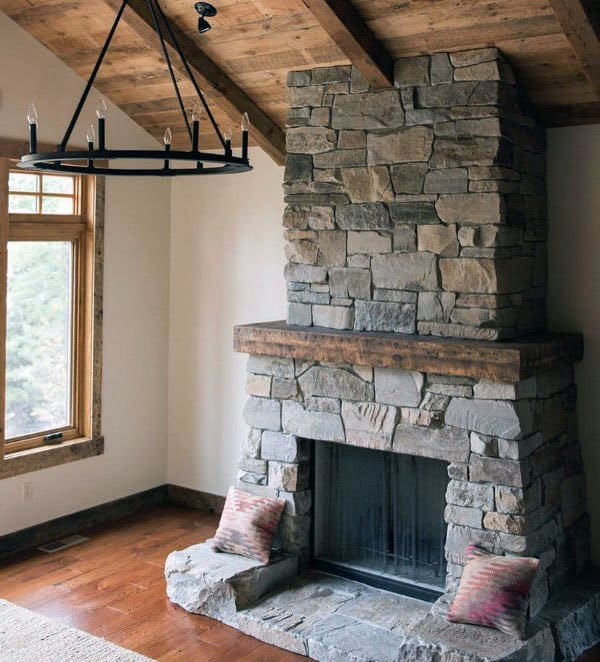 Wood Beam With Rock Stone Fireplace Design