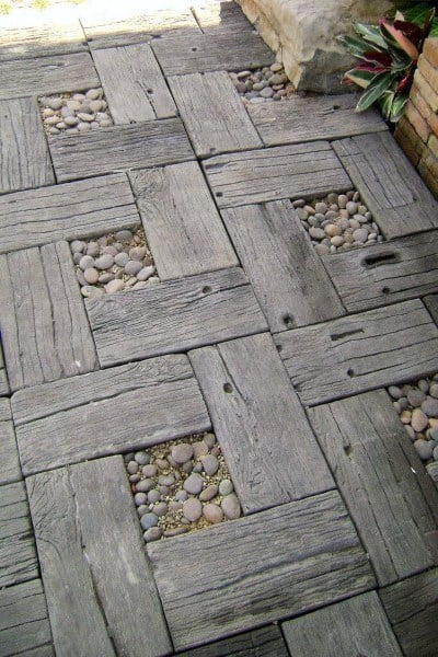 Wood Board Pattern With Pebble Rocks In Center Walkway Ideas