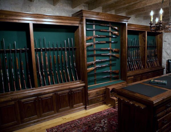 Wood Cabinets With Green Backing In Gun Room