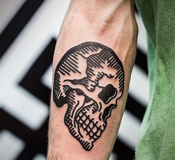 woodcut-guys-traditional-inner-forearm-black-ink-skull-tattoos
