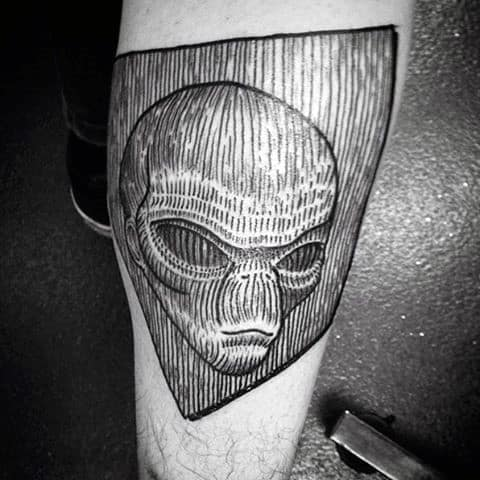 Woodcut Male Alien Head Arm Tattoos