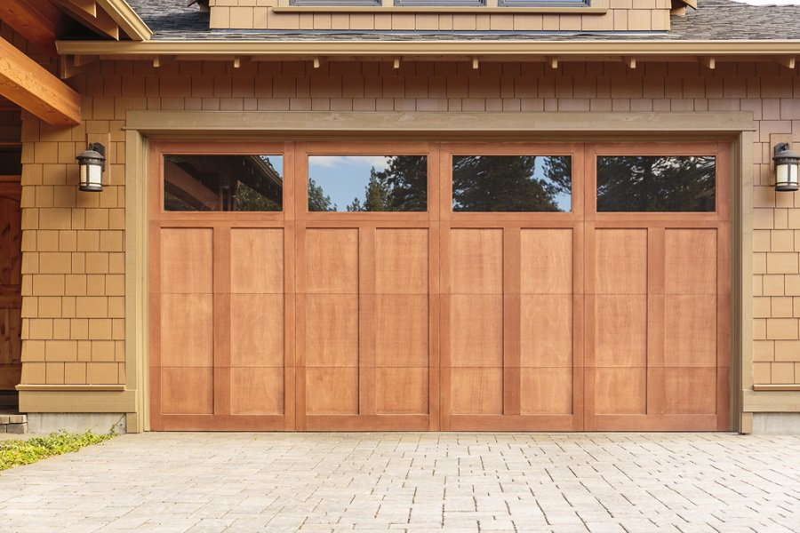 Wood Siding With White Painted Garage Door Windows