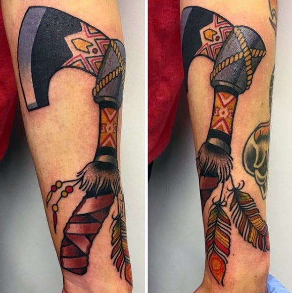 Wrist And Forearm Tomahawk Tattoo With Feathers For Guys