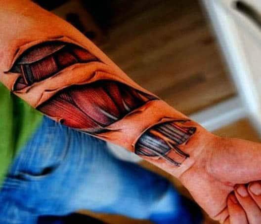 Wrist Male Ripped Skin Mechanical And Muscle Tattoo