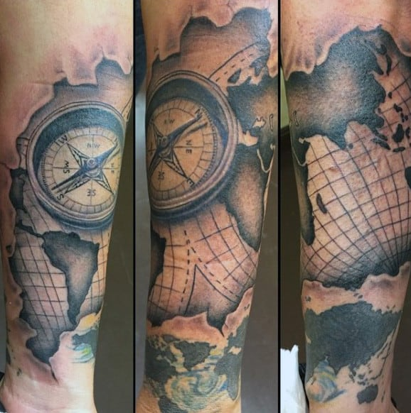 50 world map tattoo designs for men adventure the globe wrist mens tattoo of world map and compass gumiabroncs Images