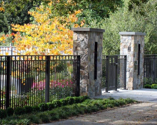 Wrought Iron Black Front Yard Fence Ideas With Stone Pillars