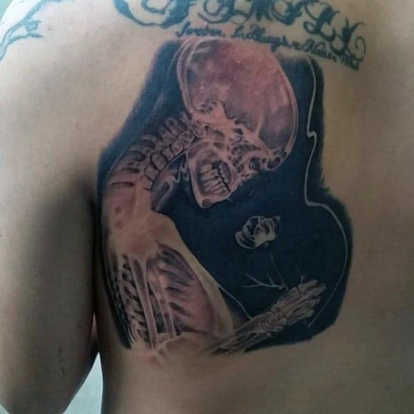 X Ray Skeleton Holding Rose Flower Mens Bone Tattoo On Back