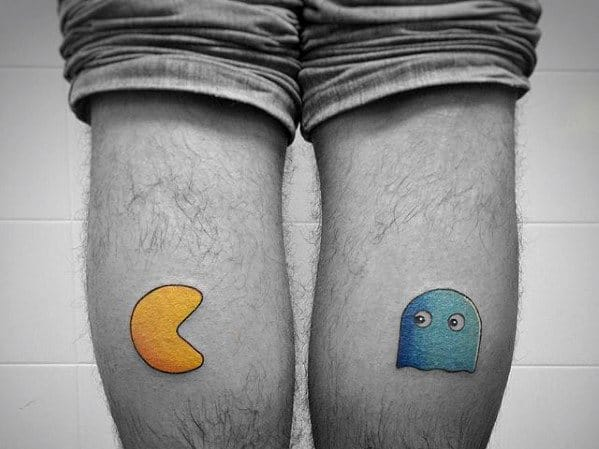 Yellow Pacman With Blue Ghost Mens Back Of Leg Calf Tattoos