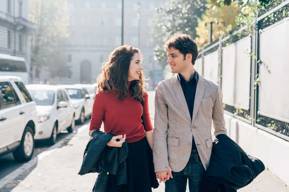 young beautiful couple walking