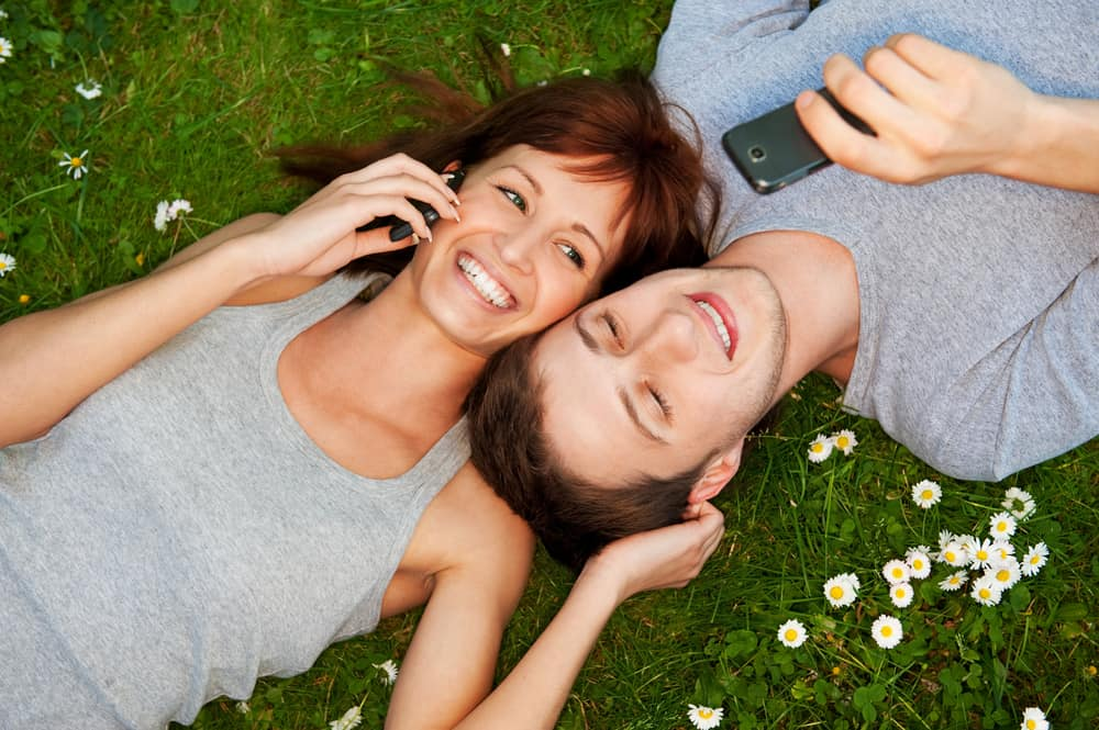 young couple using mobile phones