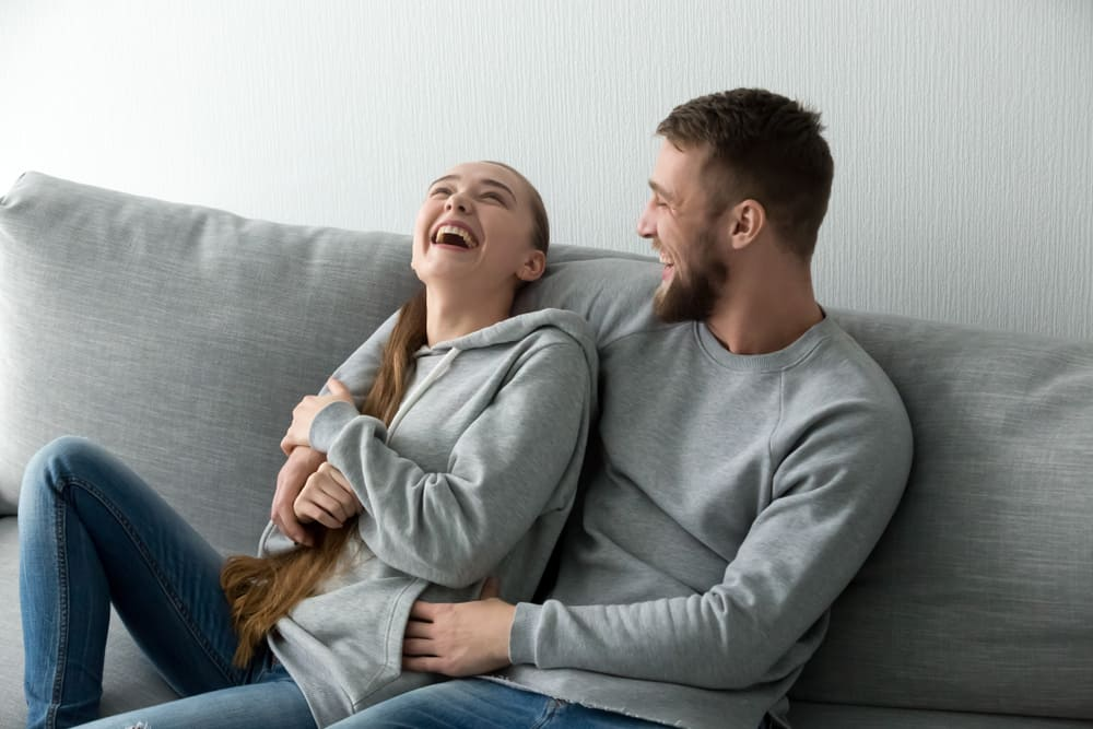 young happy couple having fun talking
