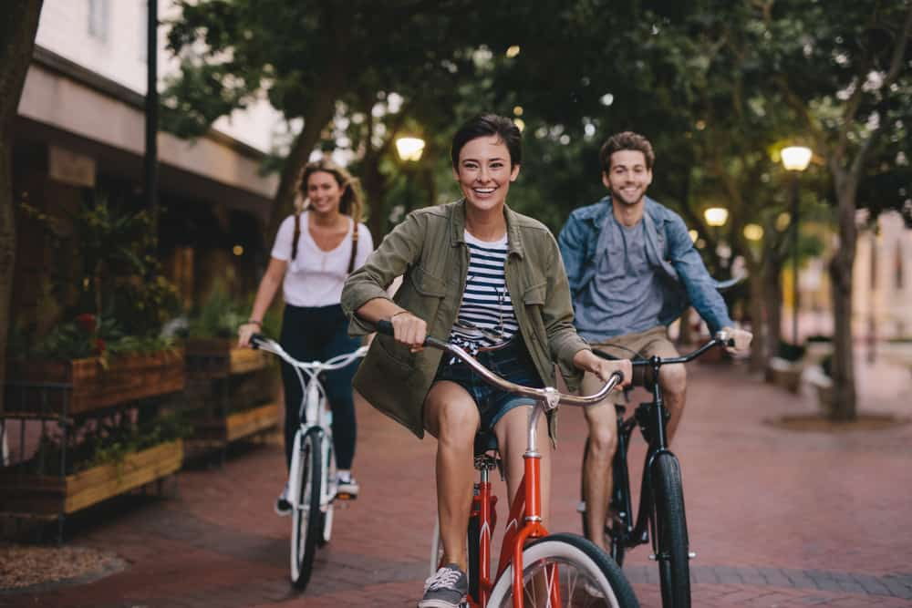 young people cycling on the street