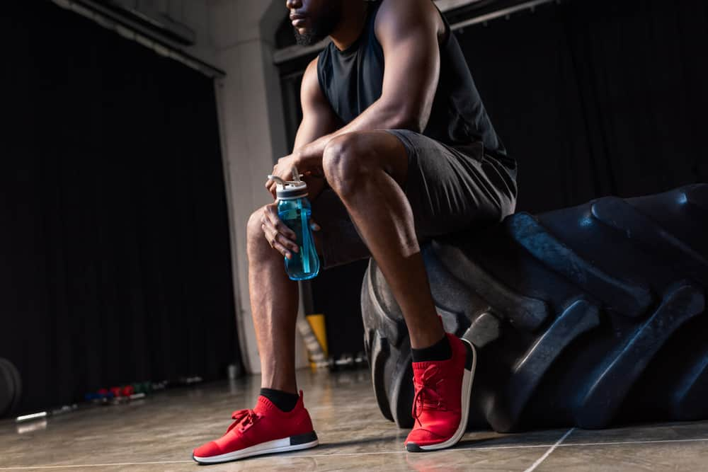 young african american sportsman wearing red shoes