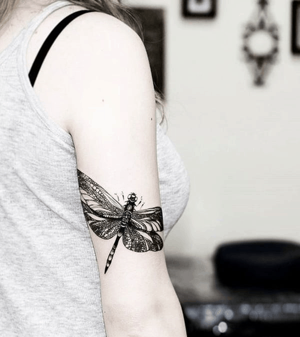 The intricate dragonfly covering the bicep to rock off in the summers with the sleeveless dress