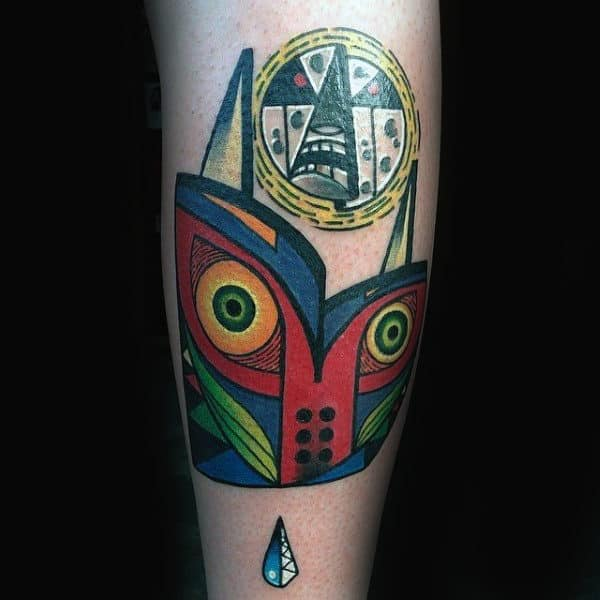 Zelda Abstract Majoras Mask Tattoo On Male